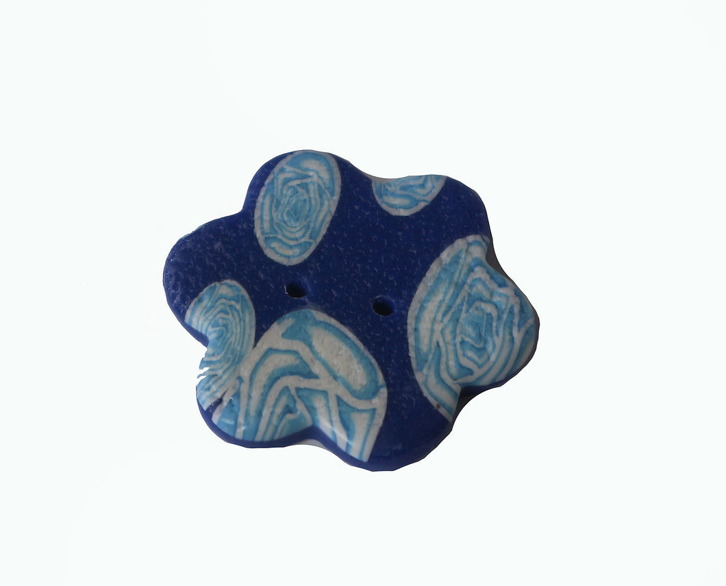 blue flower button with white flowers