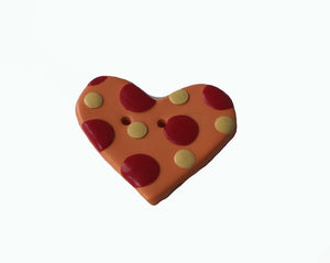 orange heart shaped button with red and yellow dots