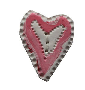 white and pink heart shaped textured button