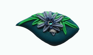 blue leaf shaped button with sculpted flowers and crystal