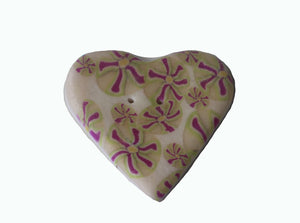 large heart shaped white button with purple flowers
