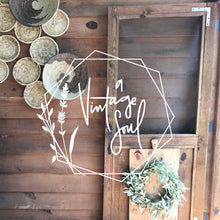 Load image into Gallery viewer, A Vintage Soul's hand lettered and hand drawn logo in white on top of a photo of a screen door and wall of hanging circle bacskets.