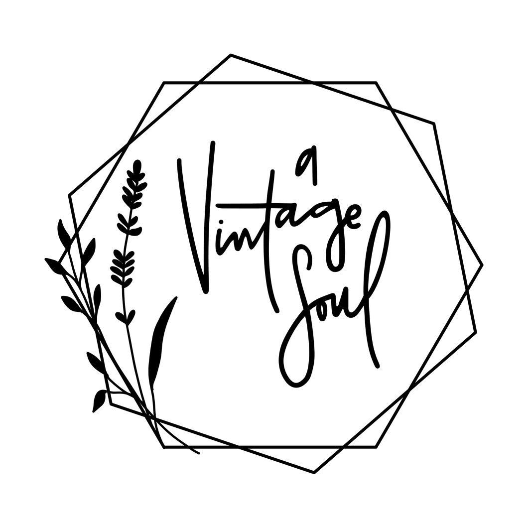 A Vintage Soul's hand lettered and hand drawn logo. The typography is a messy cursive and is surrounded by geometric hexagons and a lavender sprig all in black.