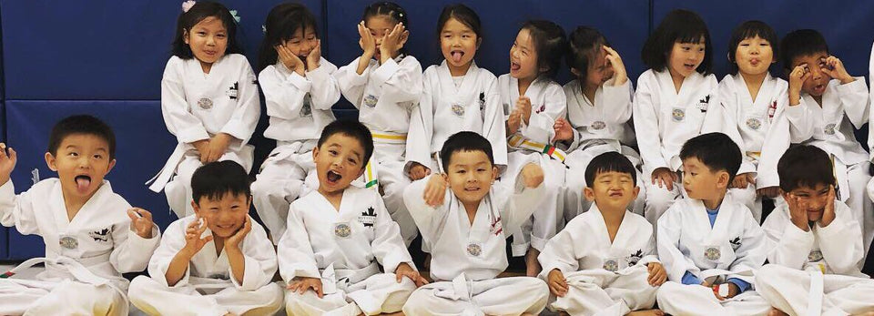 Children's Martial Arts classes in Markham.  Children having fun doing Taekwondo.  Children Learning Self Defence.  Kids making friends. Kids learning to be confident.