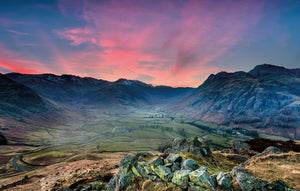 The Langdale Valley at sunset with a pink sky