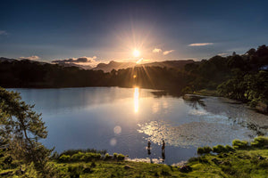 Loughrigg Tarn at sunset with two wild swimmers