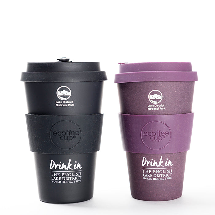 Two lake district shop gifts coffee cups, black and purple