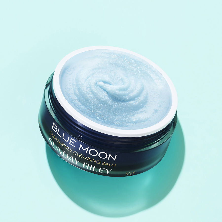 Blue Moon Clean Rinse Cleansing Balm, dark blue jar with white cap with white back ground.