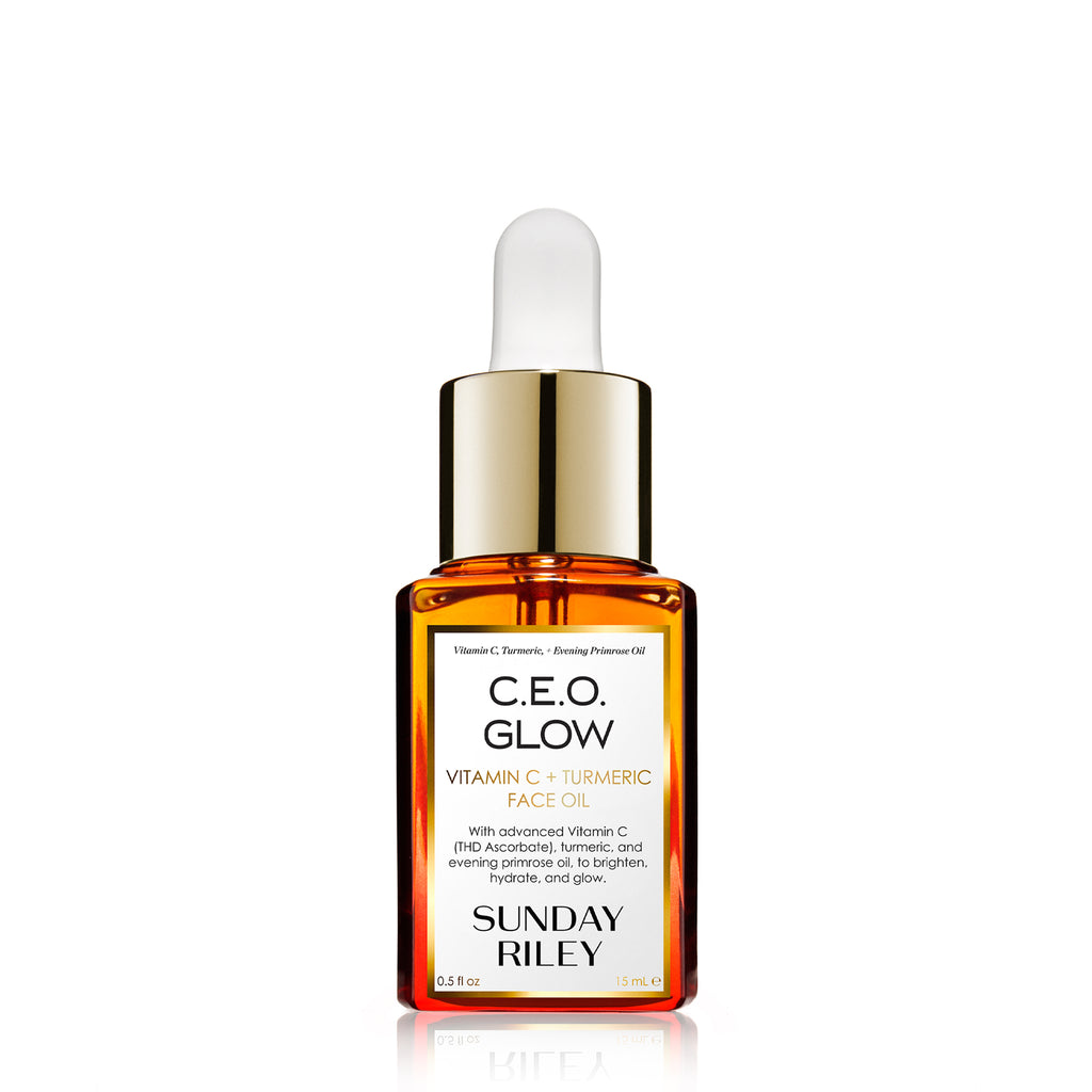 C.E.O. Glow Face Oil in a orange gradient glass bottle with silicon dropper. Edit alt text