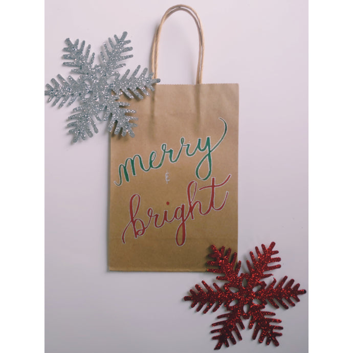 Merry and Bright Christmas kraft gift bag in the colour green and red with chrome accents