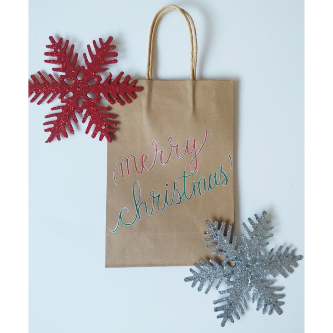 Merry Christmas kraft gift bag in the colour green and red with chrome accents
