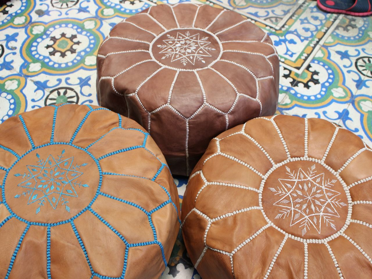 Set of 3 Moroccan brown poufs.