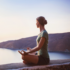 Woman meditating and living with the ebb and flow of her cycle