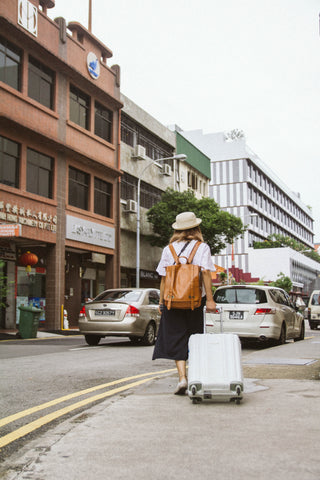 women pulling her luggage