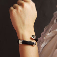 Load image into Gallery viewer, Black leather Otazu Infinity bracelet