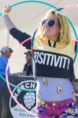 Hula hoop performer with 3 polypro dance hula hoops in nz at a festival