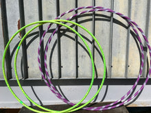 Load image into Gallery viewer, two sets of custom made hula hoops, one lime green hula hoop twins and another in purple and polypro hoop