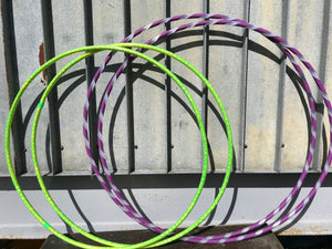 two sets of custom made hula hoops, one lime green hula hoop twins and another in purple and polypro hoop