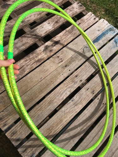 two lime green hula hoops with holographic tape pictured on a pallet