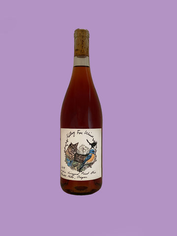 rose wine bottle against purple background