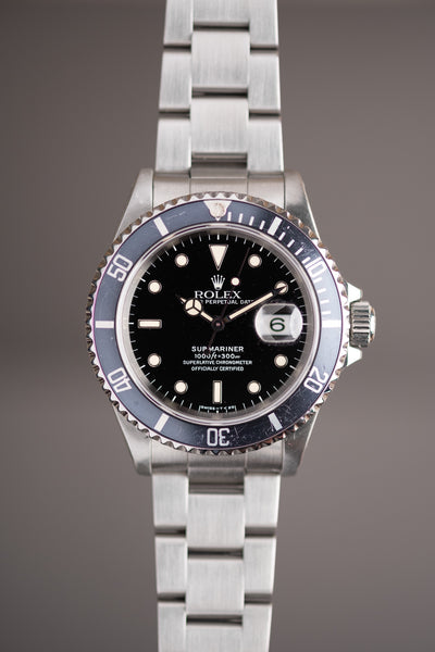 1996 Rolex 16610 - Box and Papers Blue insert