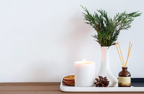 botanical decor from your yard with candles and seasonal scents