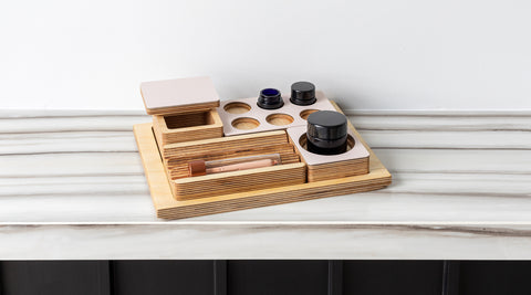 Forti Goods Petal over Baltic Birch accessories and UV glass jars.