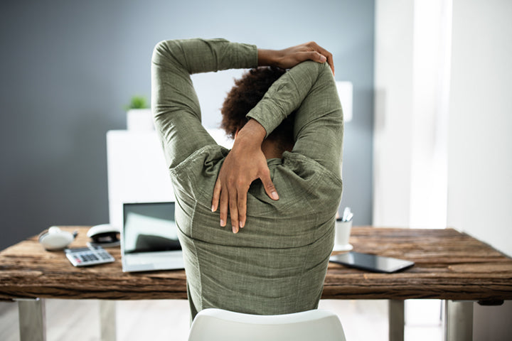 Woman stretching at work for stress relief