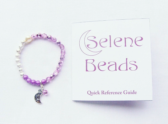 Pink and Silver Selene Beads Bracelet next to instructions