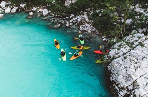 Kayakers discussing Mimi & Boo supplements for better health