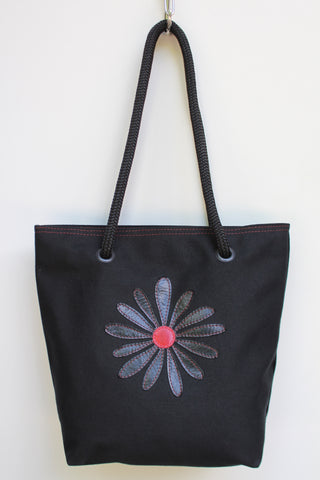 Black daisy red