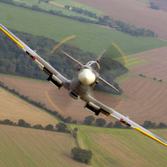 Air to air image of a Spitfire, taken over RAF Coningsby