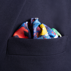 Football silk pocket square by Otway & Orford, Corner Kick, folded in top pocket. Made & hand-sewn in England in collaboration with artist Julia Tanner