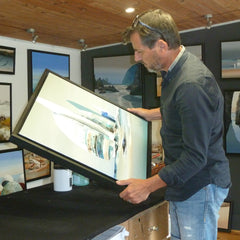 Otway & Orford pocket squares' artist Pierre Joubert in his studio gallery with one of his sailing paintings