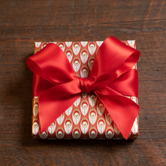 Otway & Orford red & gold gift wrap with red satin ribbon bow