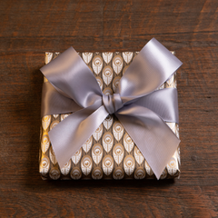 Otway & Orford black, grey & gold gift wrap with hand-tied grey satin ribbon bow