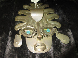 A face decoration available at Angie O'H Antiques