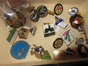 Collector pins that are available at Angie O'h Antiques
