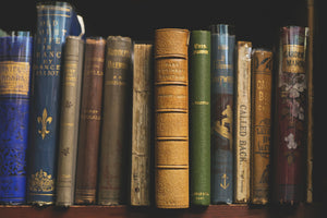 Old Antique books standing beside each other
