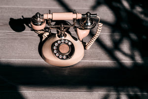 Antique pink dial phone