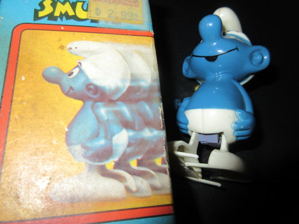 NORMAL SMURF WALLACE AND BARRRIE WIND UP TOY WITH BOX TORN LID AS IS PRICE INCLUDES SHIPPING AND HANDLING NO RETURNS
