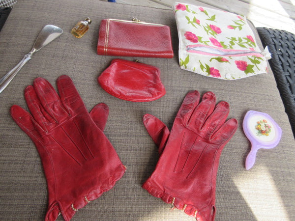 SMALL HANDS RED LEATHER WITH VERY FINE PEARLS AT WRIST WELL WORN AS IS MATCHING ACCESSORIES  WORN GRACIOUSLY BY A KINDLY CARING AUNT C1960'S WITH MATCHING COIN PURSE, SHOE HORN, MIRROR AND MINI WALLETT