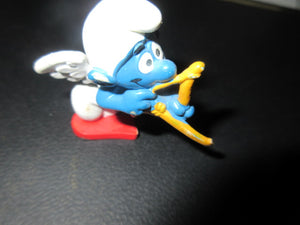 SMURF CUPID BOW AND ARROW MADE IN WEST GERMANY PEYO SCHLEICH SHIPPING AND HANDLING INCLUDED IN PRICE NO RETURNS