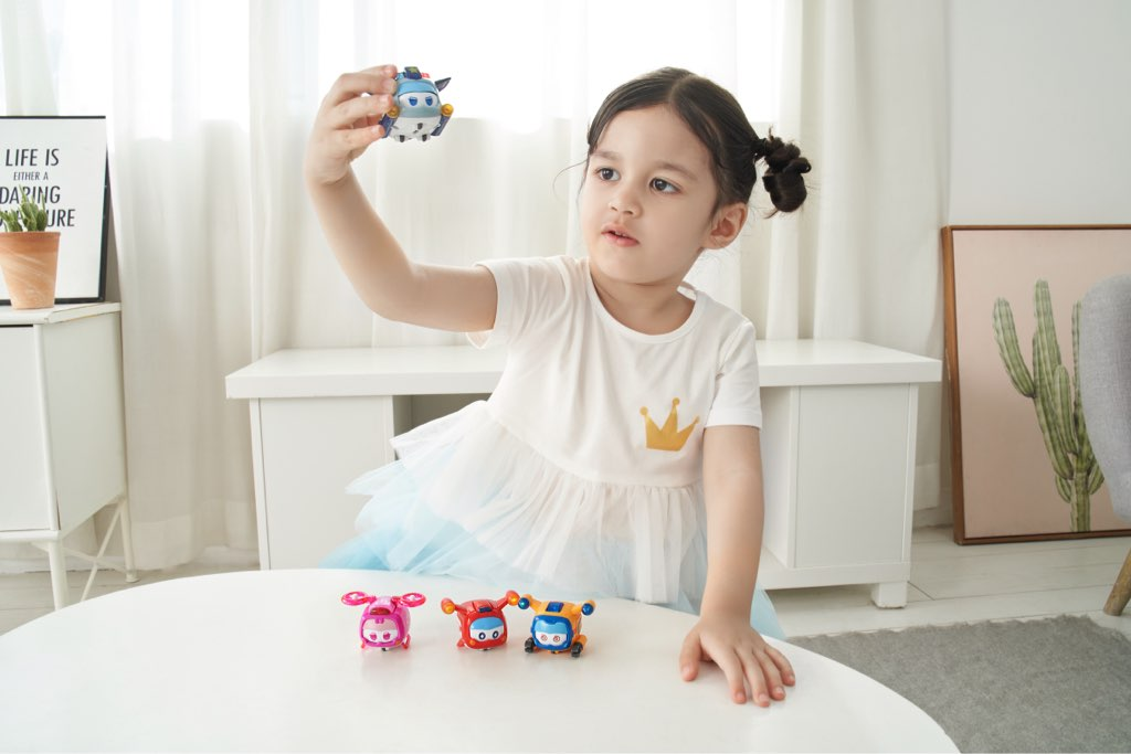 Girl playing with Super Wings - Season 5 Super Pet 4-pack