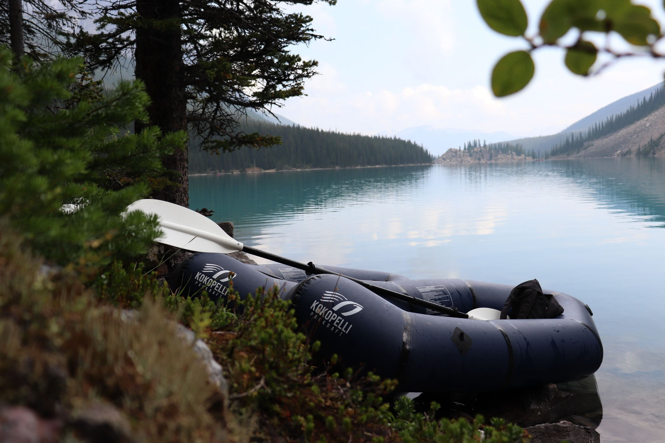 Packrafts docked by a lake. Why the Hornet Life Kokopelli Packraft is for you