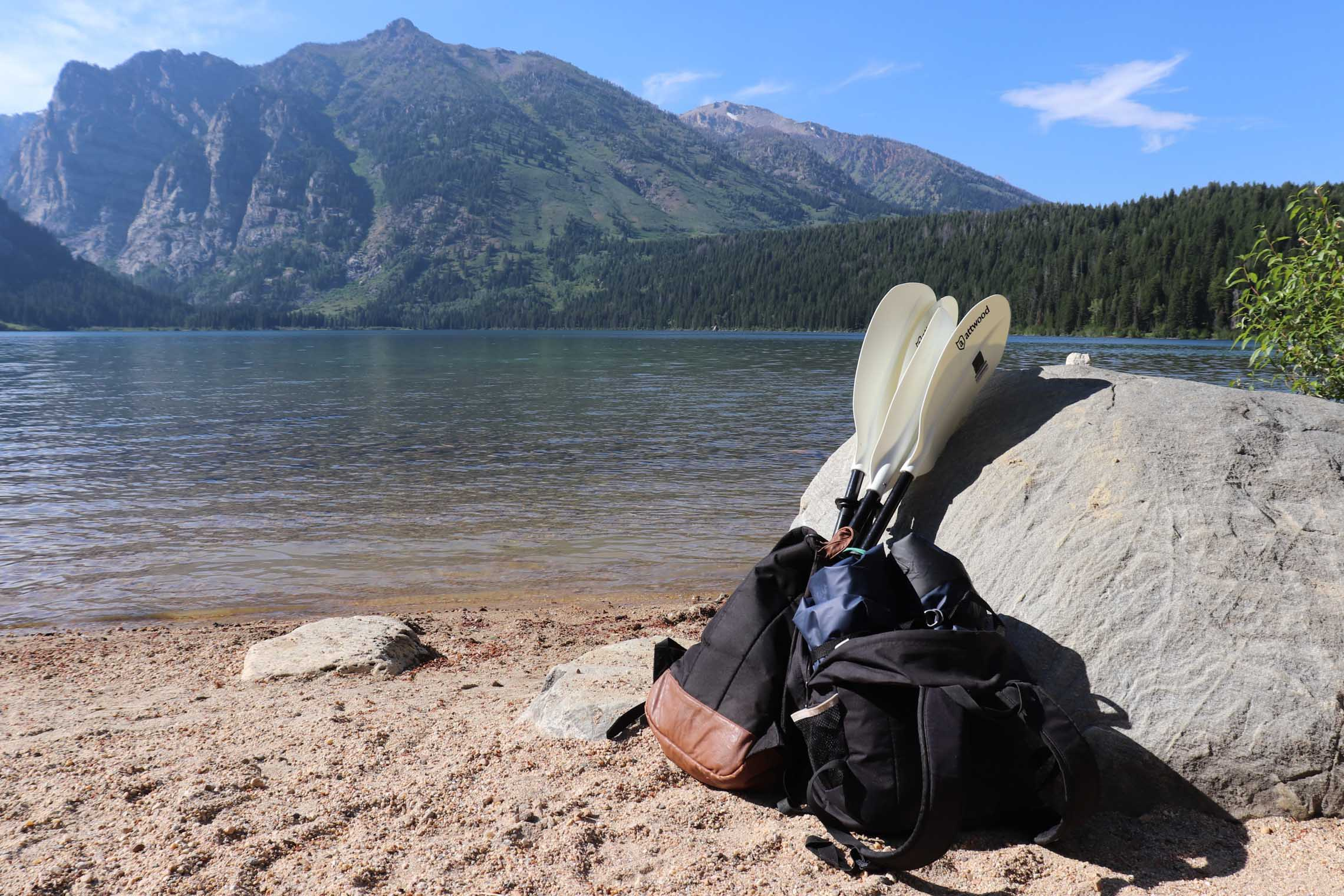 Packed up packraft next to a lake. Why the Hornet Life Kokopelli Packraft is for you