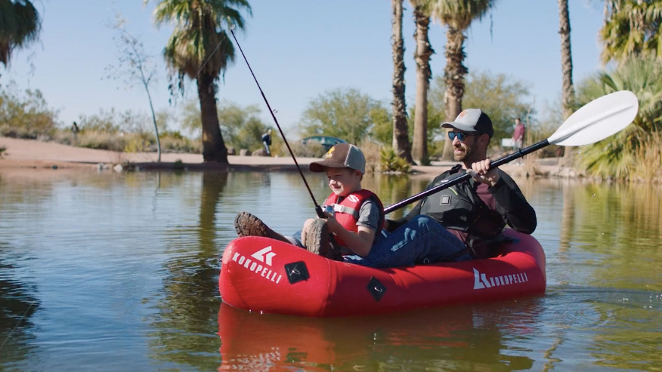 Dad and son fishing in a packraft. Kokopelli XPD Packrafting Adventures