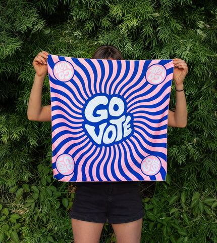 GROOVE TO THE VOTE bandana that has a Milton glazer aesthetic with the pink and blue swirls