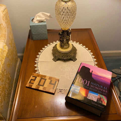 204 wood coasters shown on side table with book