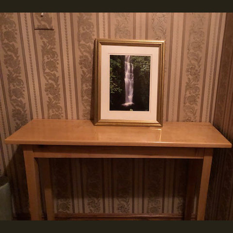 Maple console table with picture frame on display